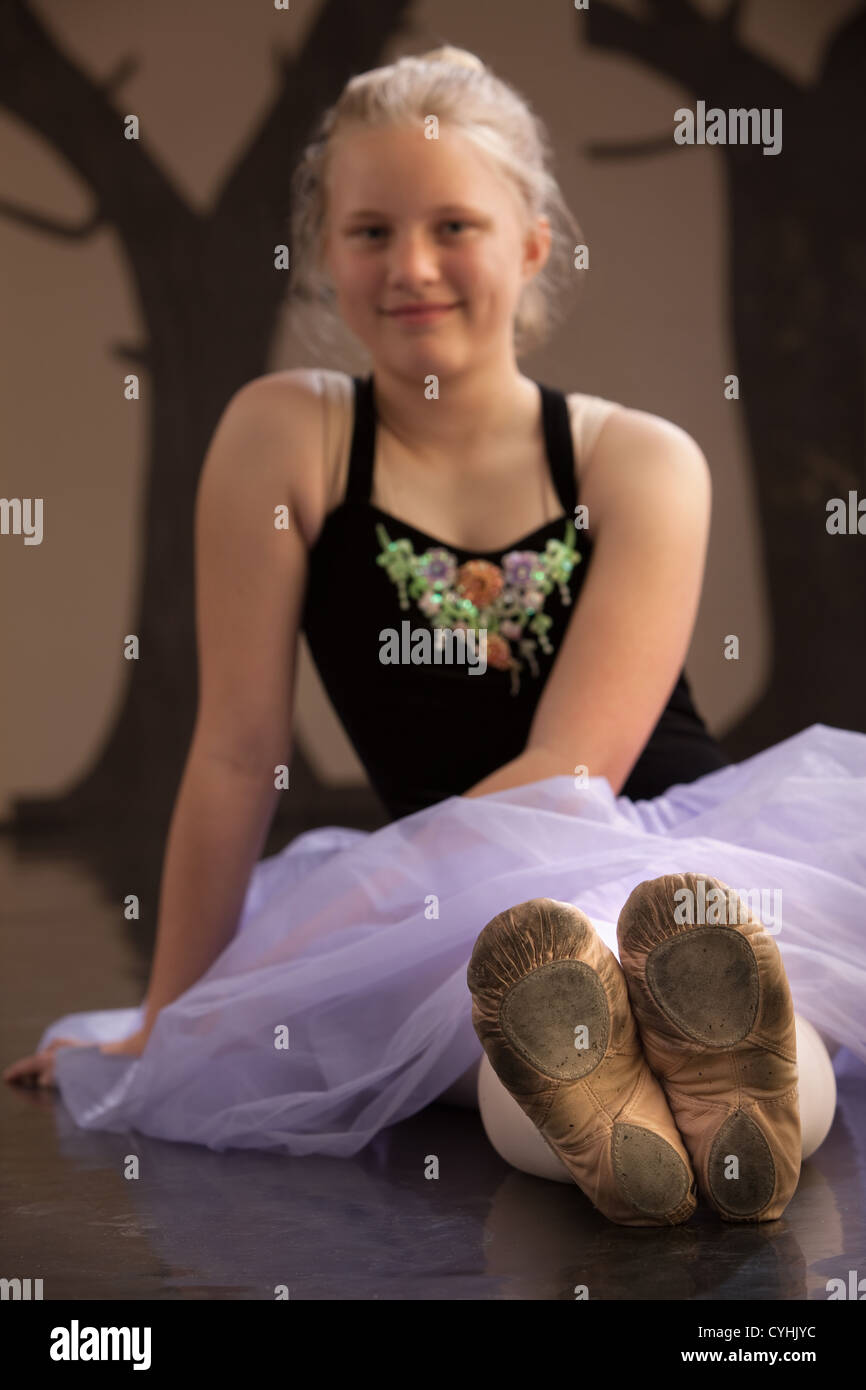 Worn out shoes of a ballet student. Shoes in focus - Stock Image