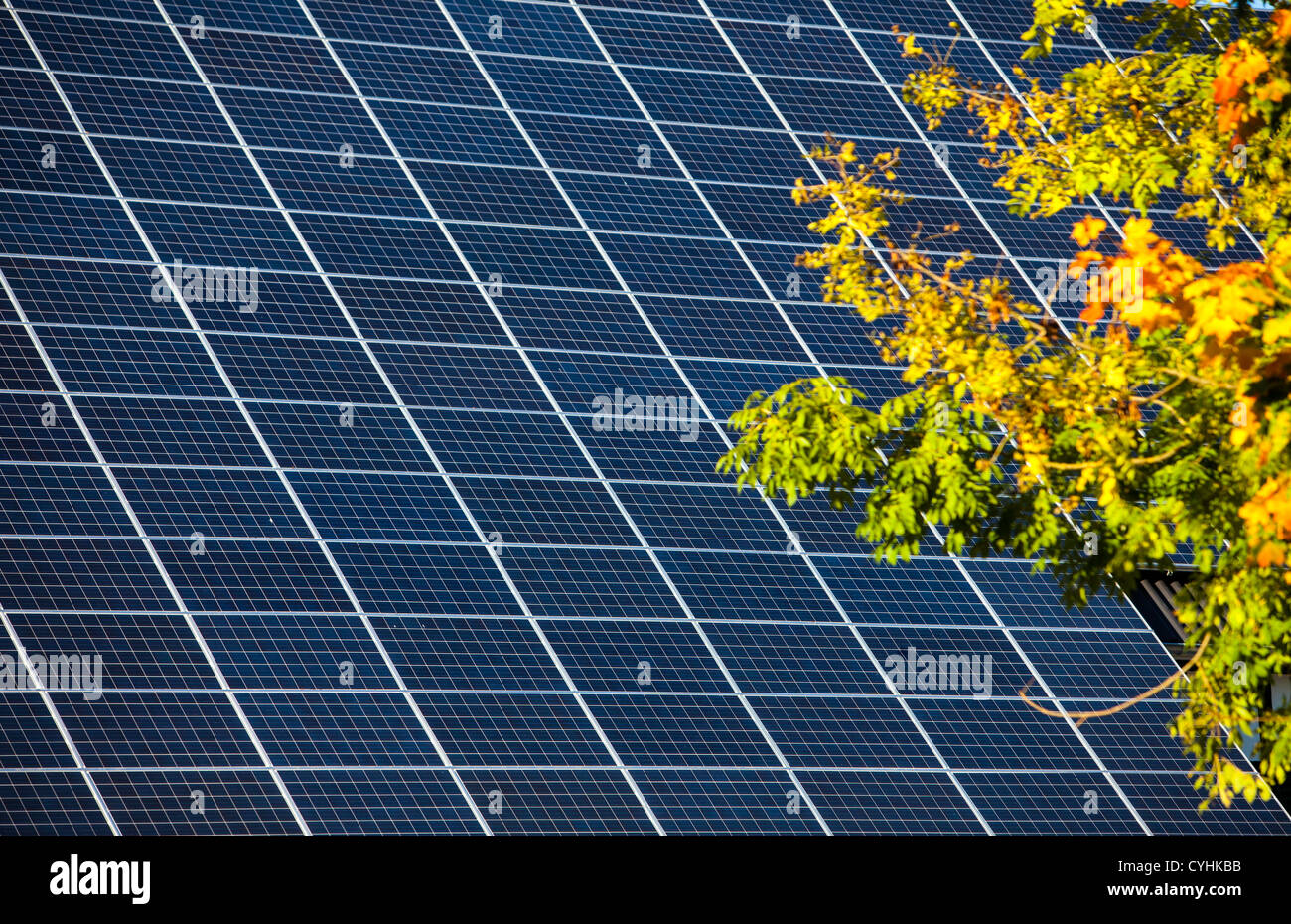 Solar panels on a roof of a farm house. - Stock Image