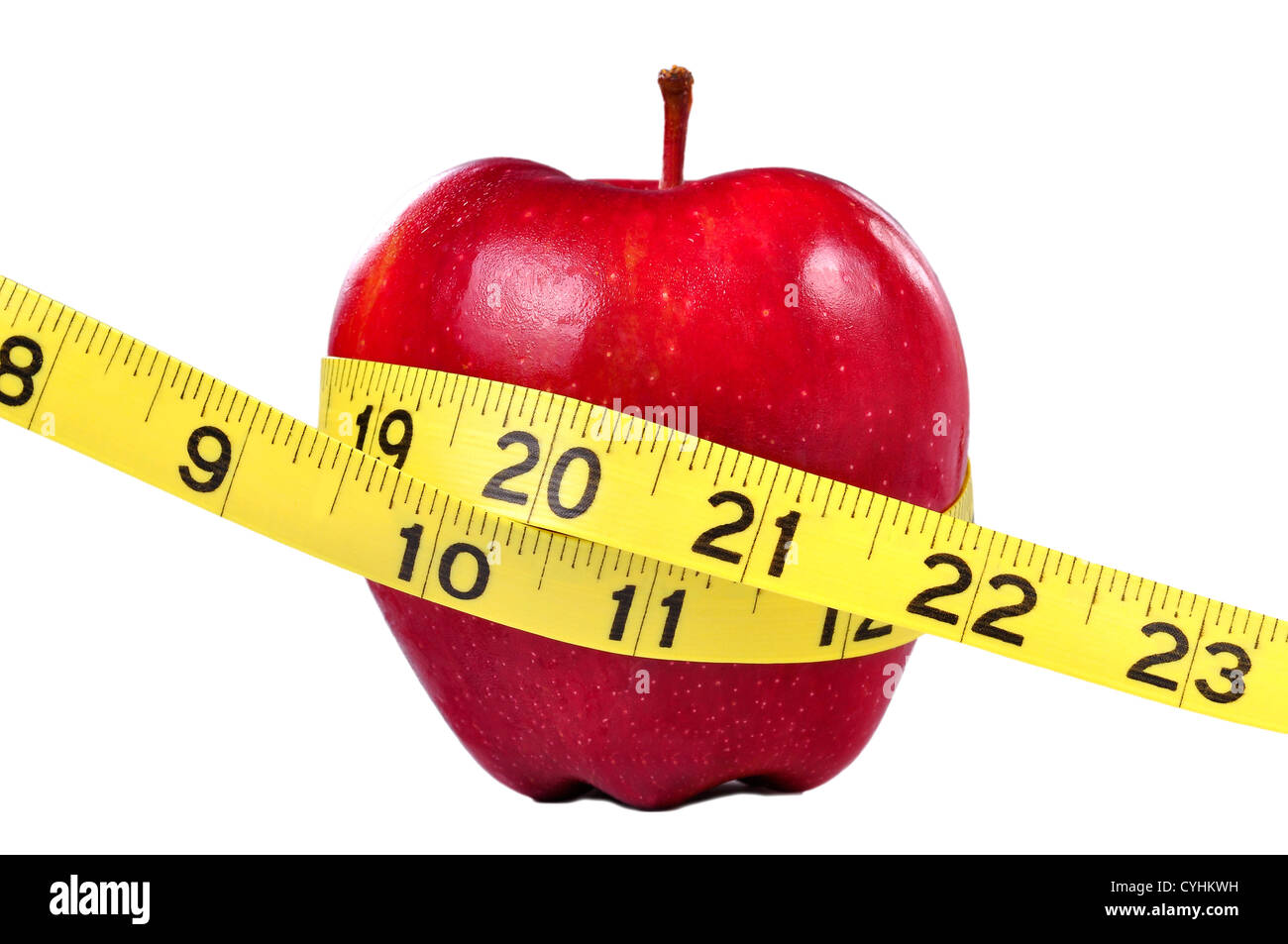 Red apple and yellow measuring tape to symbolize an healthy diet and body weight control. - Stock Image