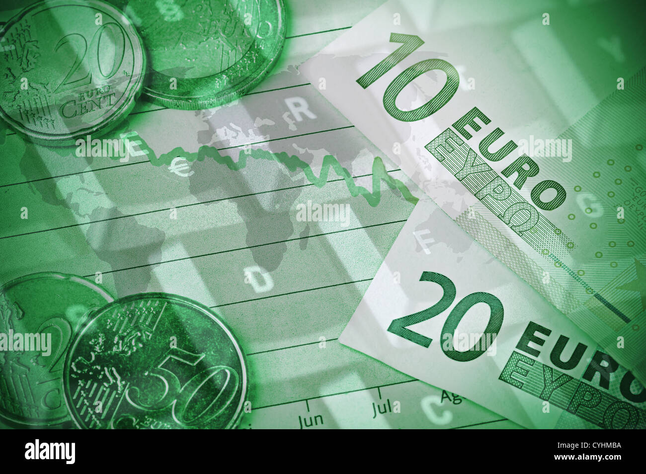 A couple of bills and coins on top of a graph together with a world map and a computer keyboard. - Stock Image