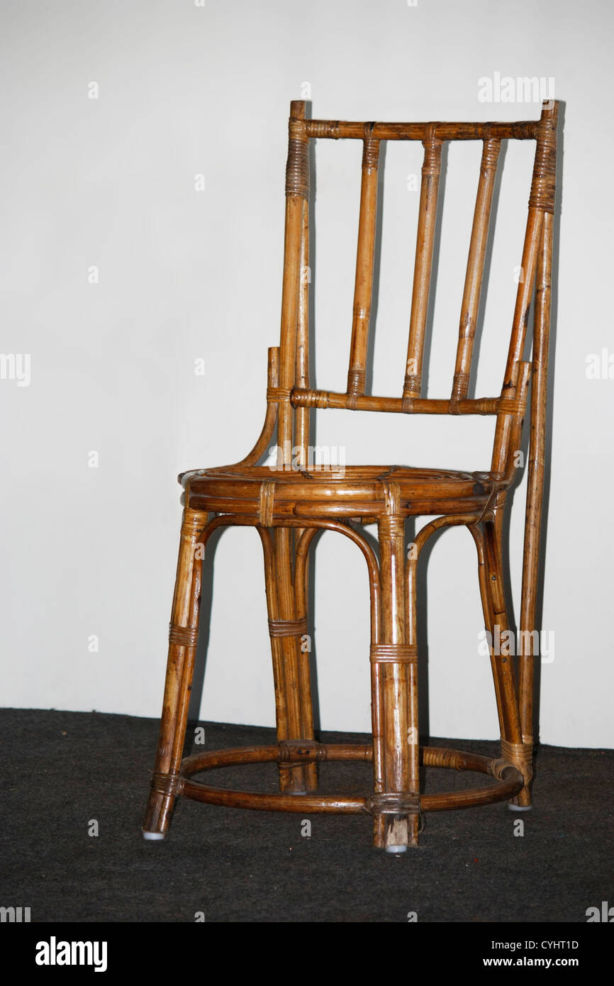 A Crafted Bamboo Furniture chair kept on a stage - Stock Image