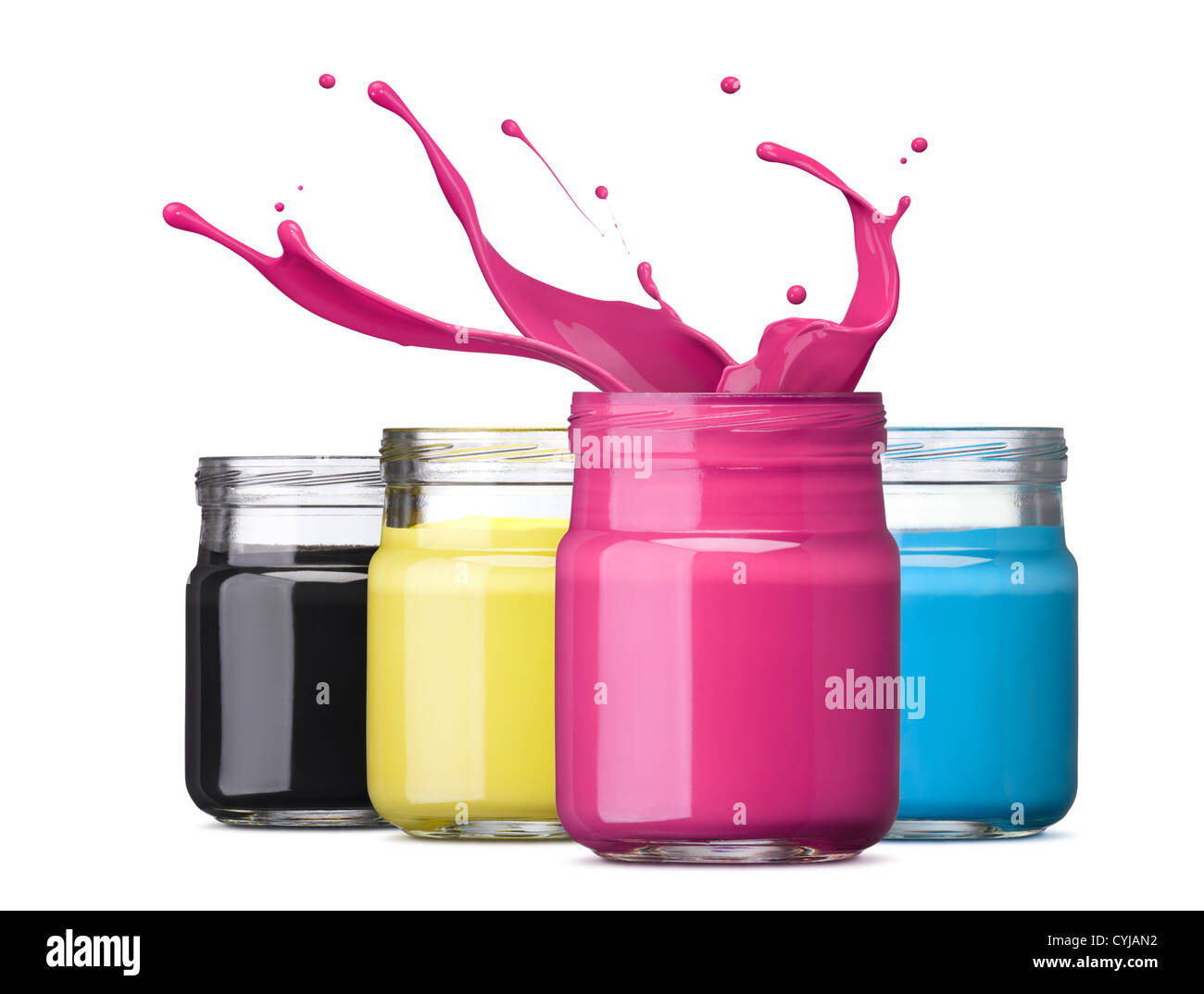 bottles of ink in cmyk colors, magenta with splash - Stock Image