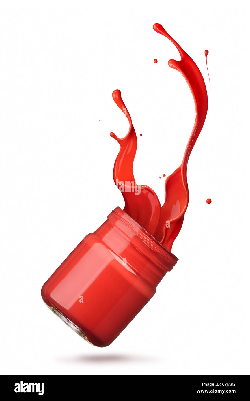 bottle of spilling red ink creating splash - Stock Image