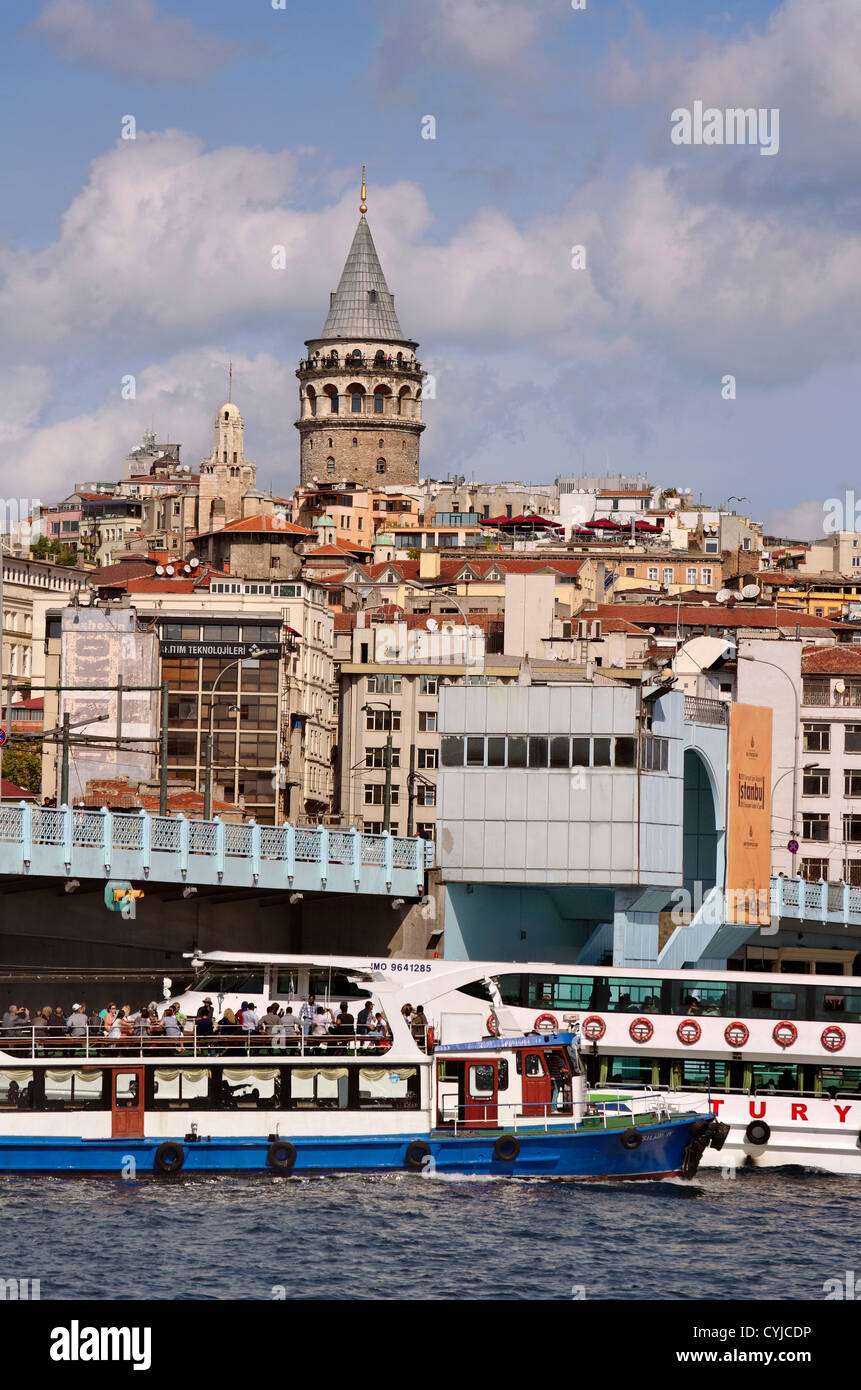 Galata Tower across the Golden Horn with Galata Bridge, Istanbul, Turkey. - Stock Image