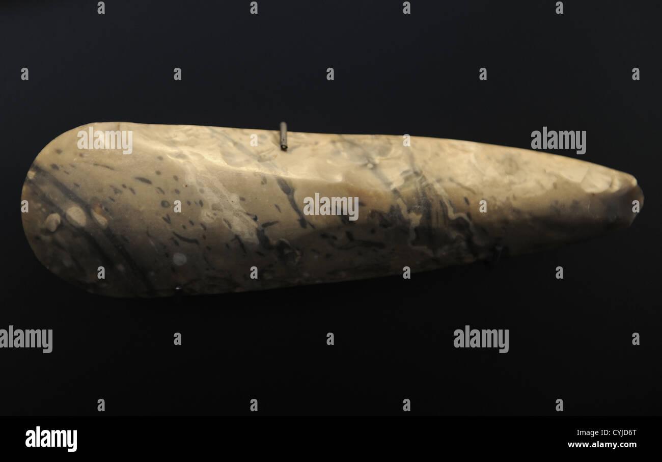 Flint axe of stone. Neolithic. From Denmark. National Museum of Denmark. Copenhagen. Denmark. - Stock Image