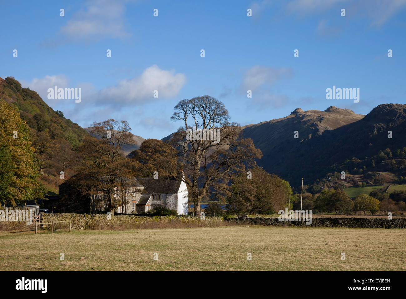 Hartsop Hall Near Brothers Water with the Hill of Angle Tarn Pikes to the Right in Autumn Lake District Cumbria - Stock Image
