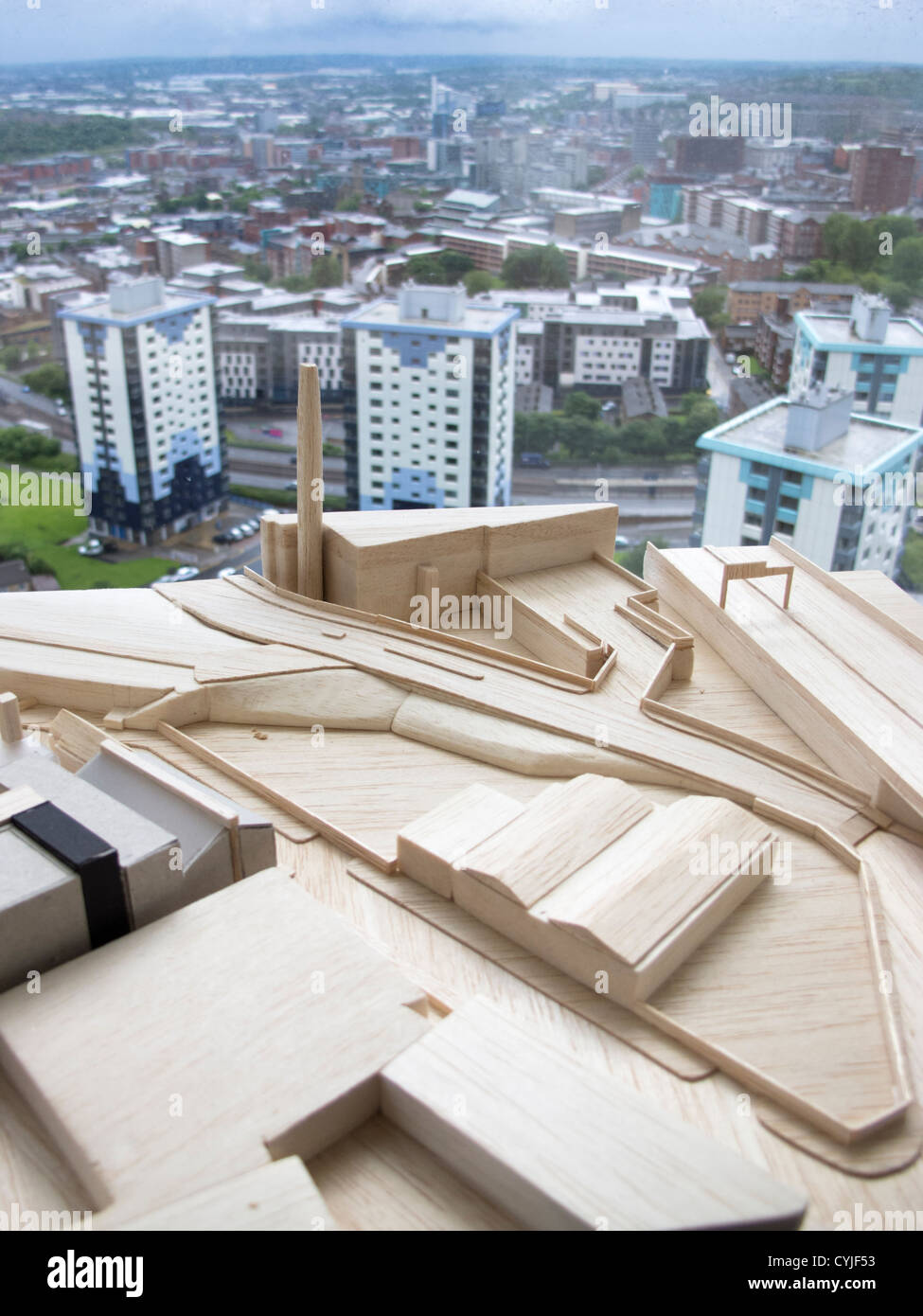 Architecture models in foreground with Sheffield city in background South Yorkshire England - Stock Image