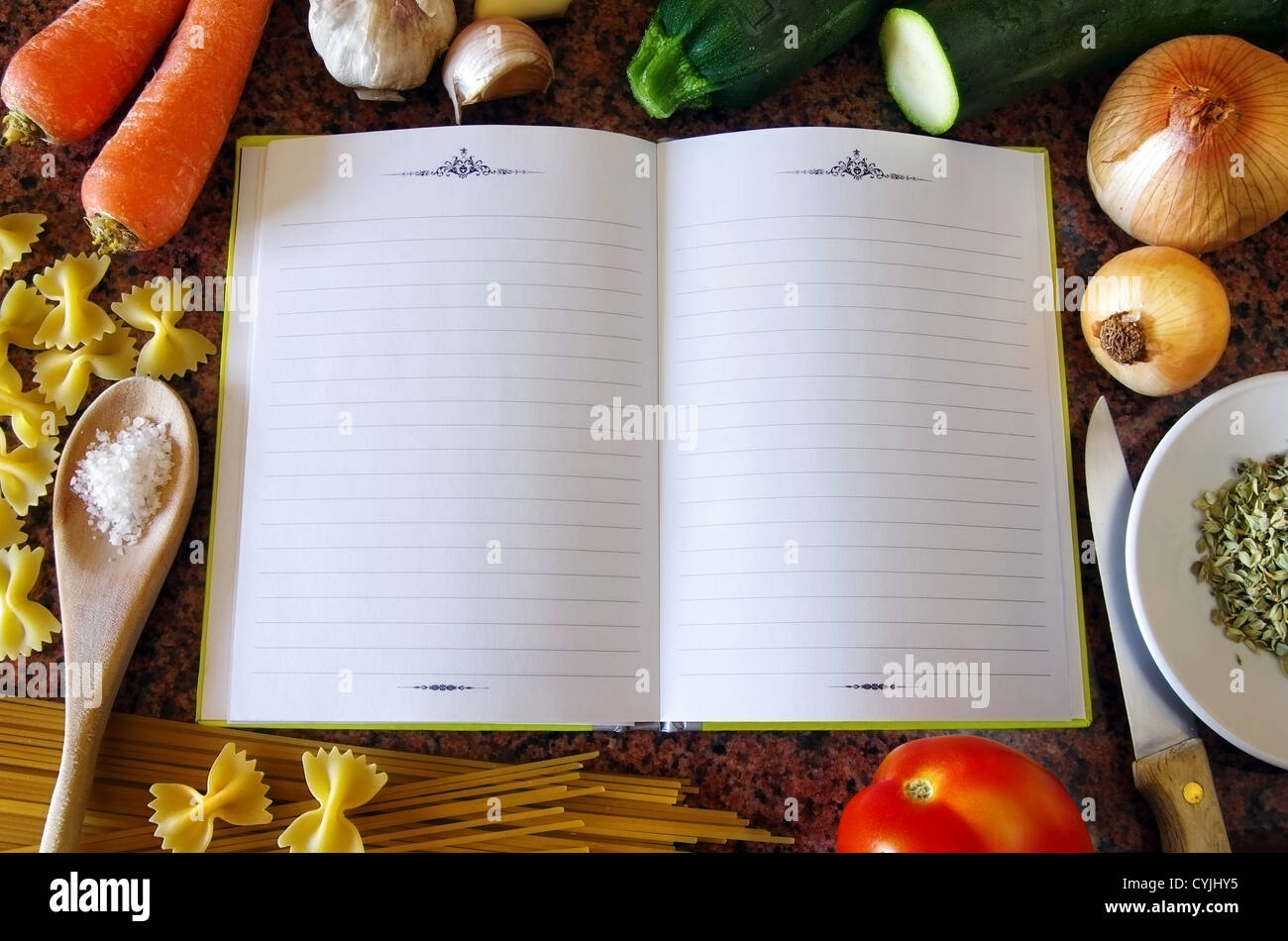 Top view of an empty recipe book surrounded of food ingredients and kitchen utensils Stock Photo