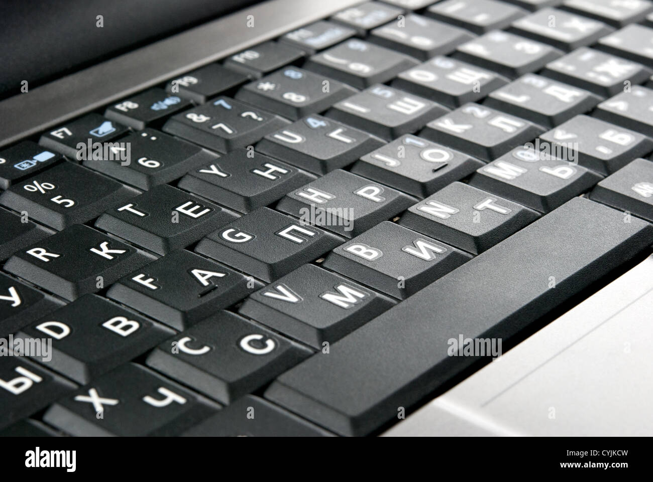 Laptop keyboard closeup. Oblique view - Stock Image