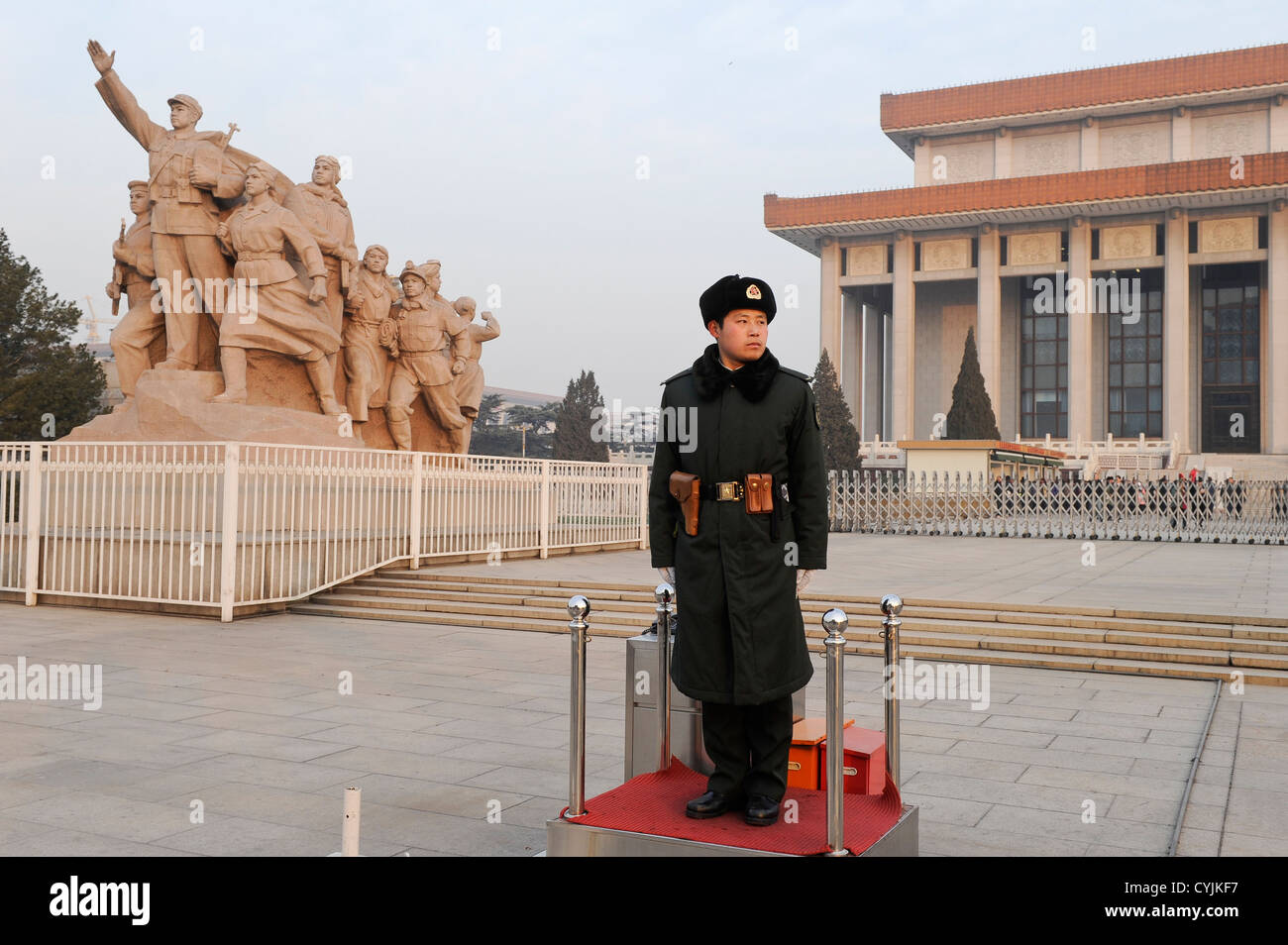CHINA Beijing Tiananmen square, soldier in front of memorial for People's Heroes and great hall of the people Stock Photo
