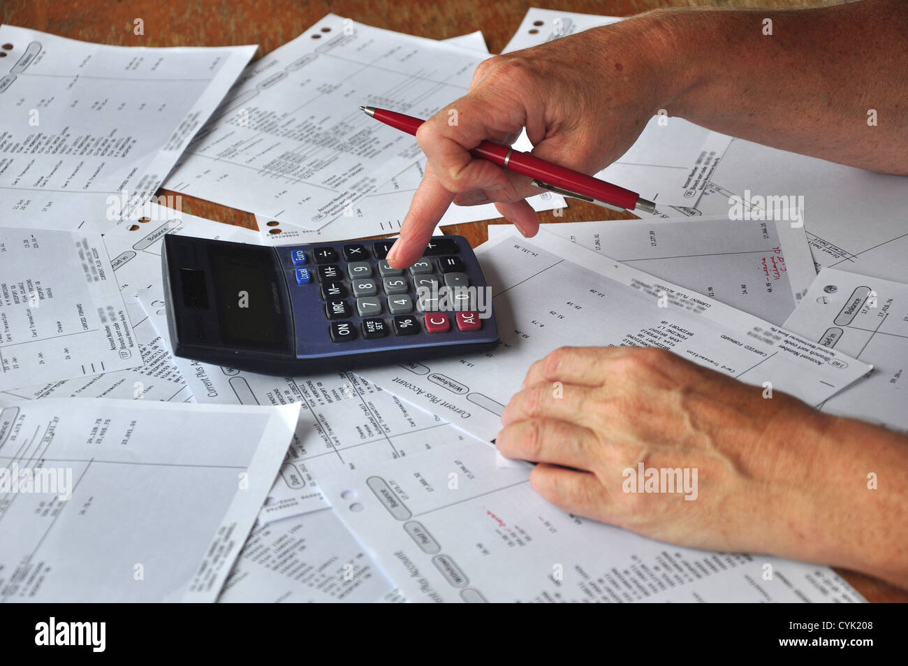 Checking the bank statements UK - Stock Image