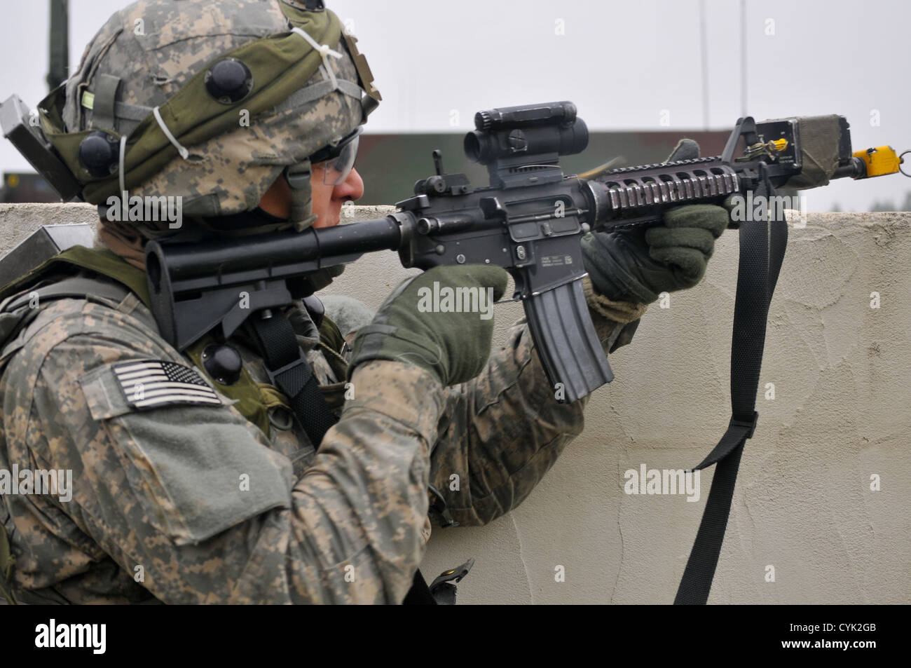 U.S. Army Pvt. Skyler Grim returns fire during a decisive action training environment exercise, Saber Junction 2012, - Stock Image