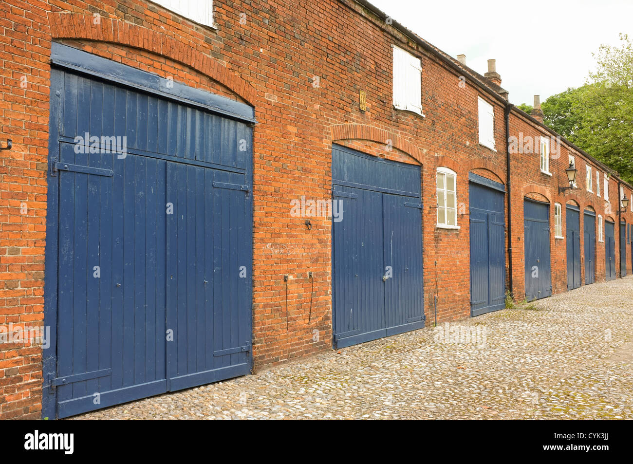 Large Blue Wooden Garage Doors, Which May Have Been The Old Stables And  Warehouses In