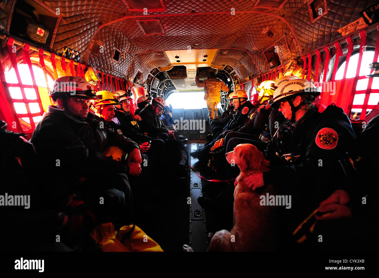 JOINT BASE MCGUIRE-DIX-LAKEHURST, N.J. – Members of Maryland Urban Search and Rescue Task Force one fly aboard a Stock Photo