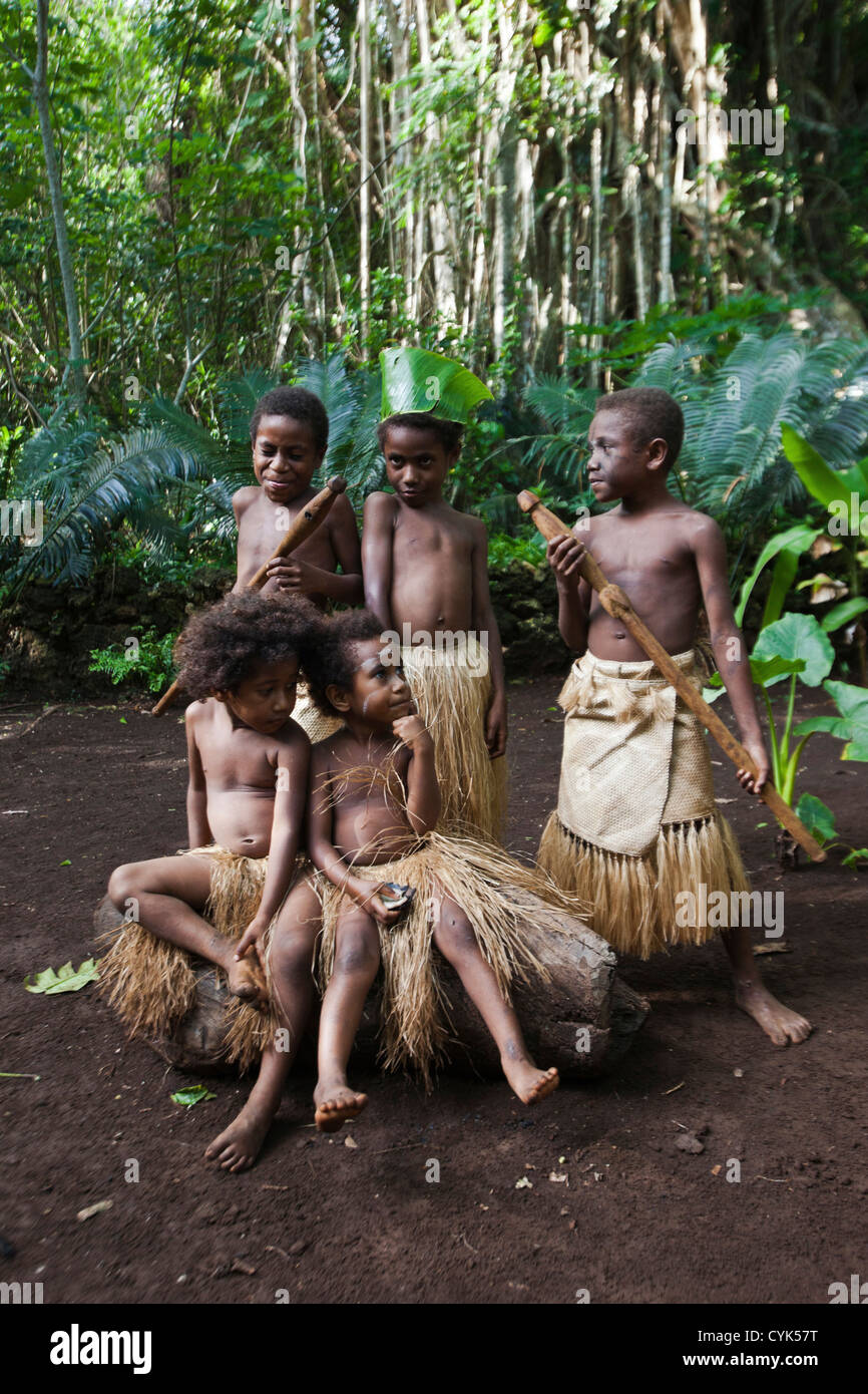 South Pacific, Vanuatu, Port Vili, Ekasup Village. Group of young boys in traditional dress during cultural performance. - Stock Image
