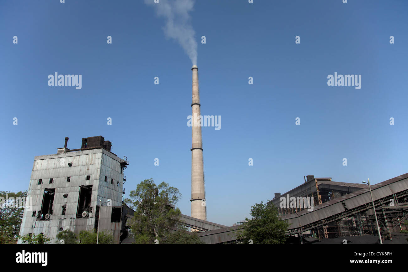 Factory chimney releasing steam - Stock Image
