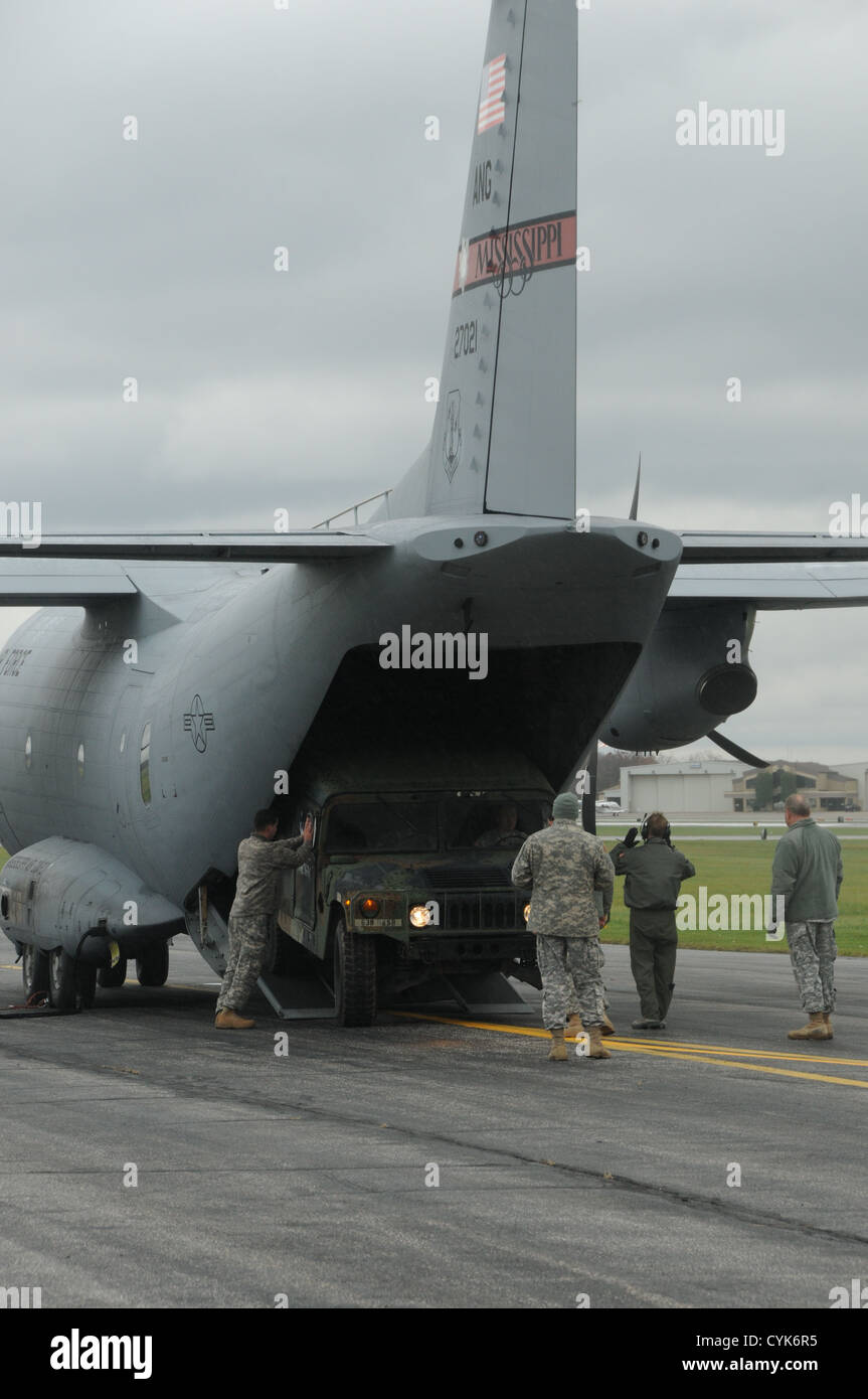 Members of the Ohio and Mississippi National Guard load a U. S. Army Humvee on board a U. S. Air Force C-27J aircraft Stock Photo