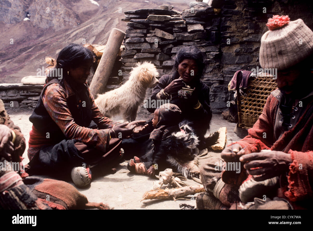 Bhotia lama monk with family on roof terrace of Bhotia village in Nar Phu Valley in the Himalayas near the Nepal - Stock Image