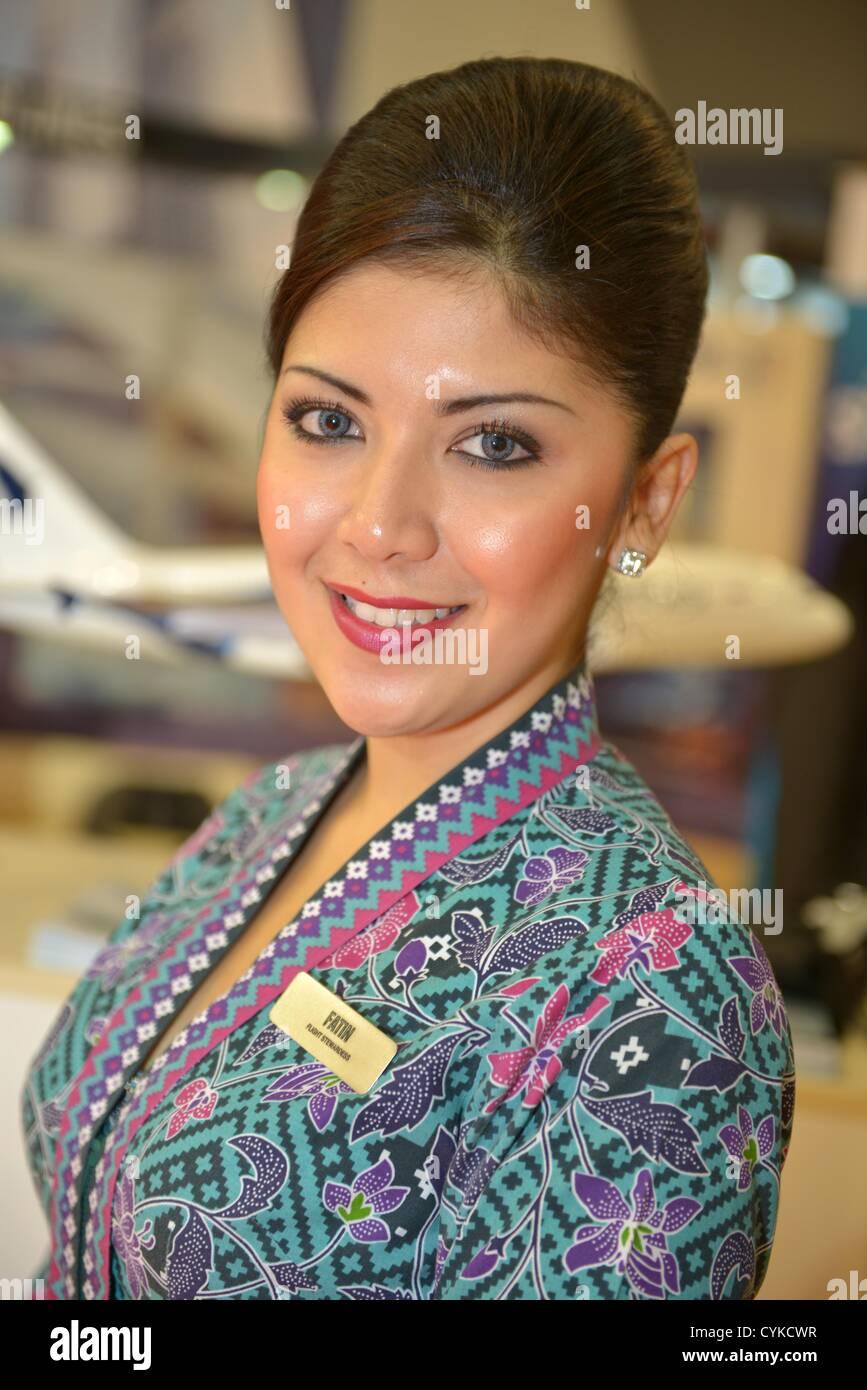 World Travel Market, London, UK  Malaysia Airlines cabin crew - Stock Image
