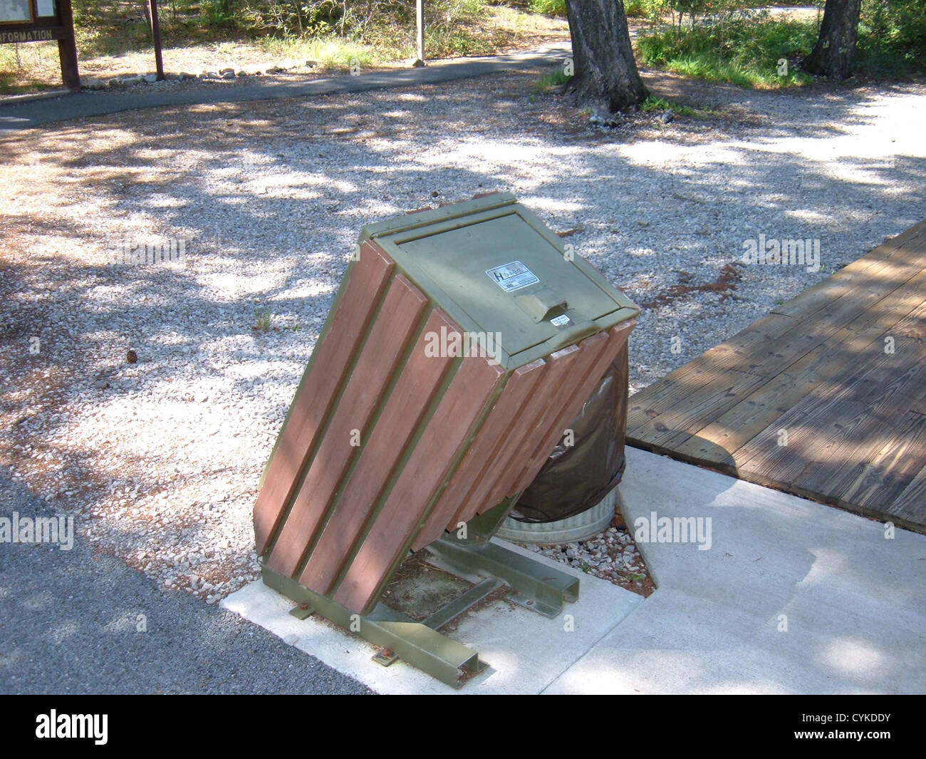 Bear-proof garbage can, located at the Train Depot in Cloudcroft, New Mexico. The container is bolted to the pavement - Stock Image