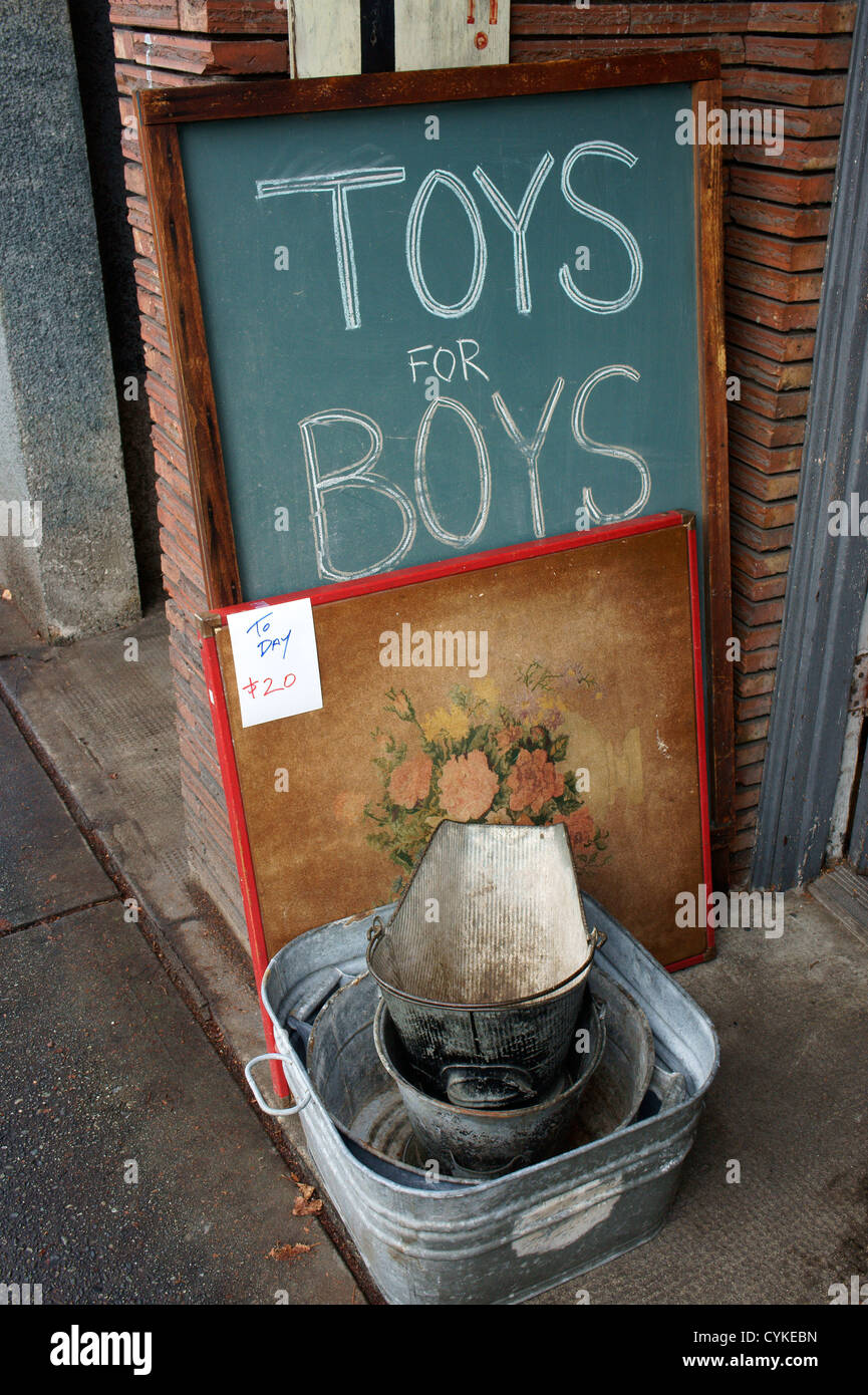 Toys for boys sign outside an antique store on Main Street, Vancouver, BC, Canada - Stock Image