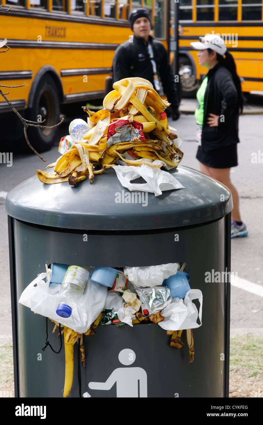 A litter bin full to overflowing - Stock Image