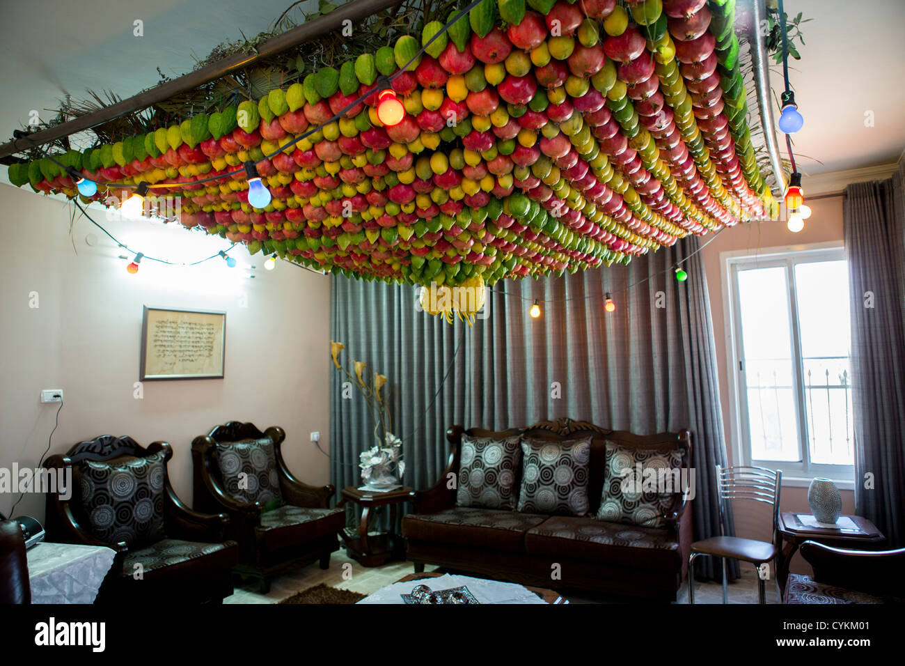Samaritan indoor Sukkah is decorated with fresh fruit on the ceiling - Stock Image