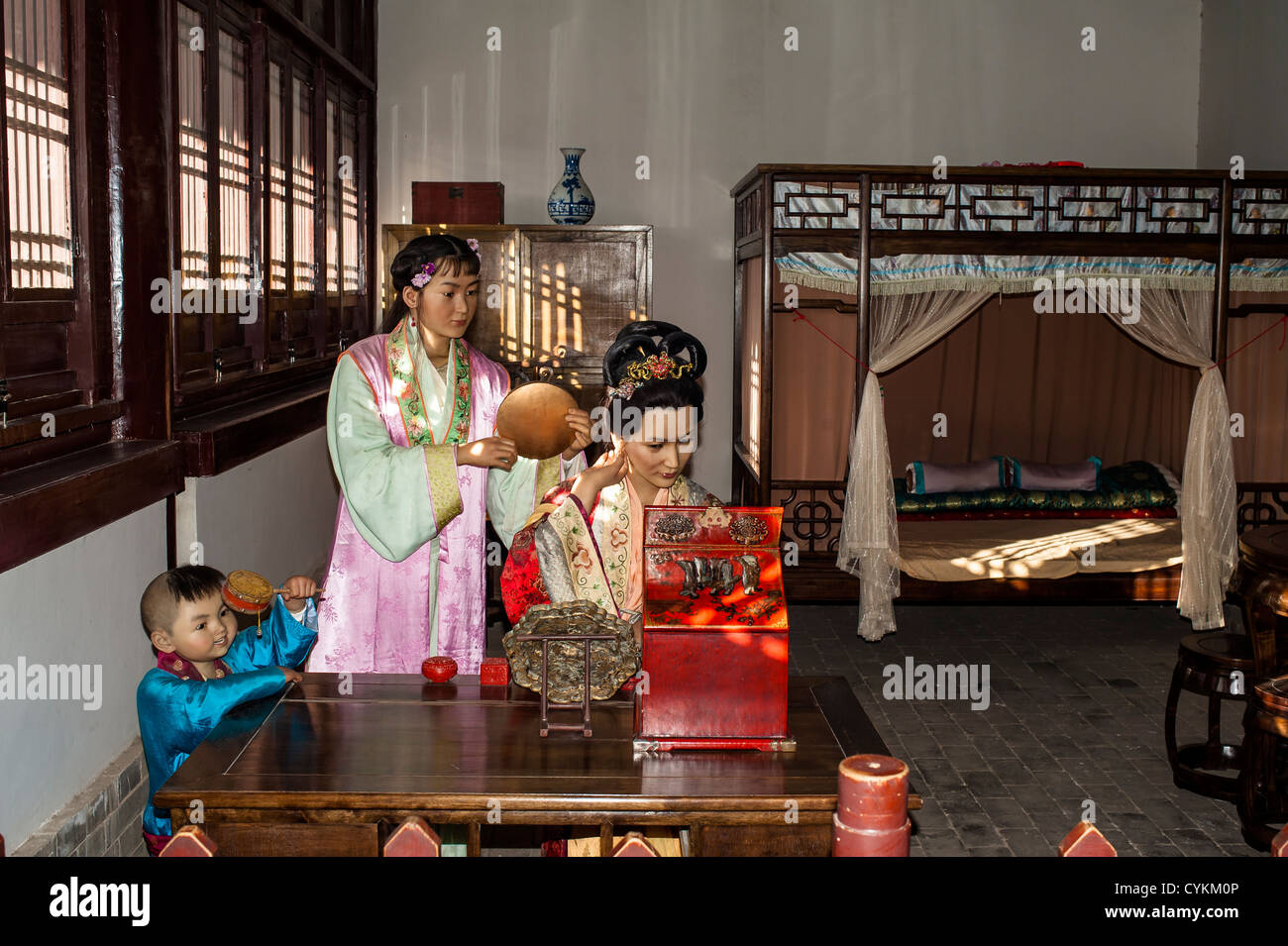 The waxwork of the family of the Ming dynasty general, Jiayuguan castle, China - Stock Image