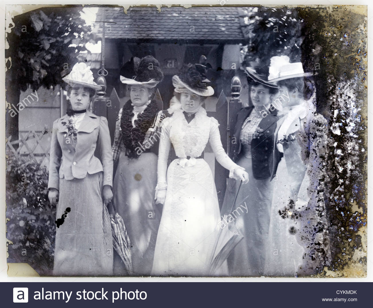 fashionable dressed women on fading glass plate image Paris 1900s - Stock Image