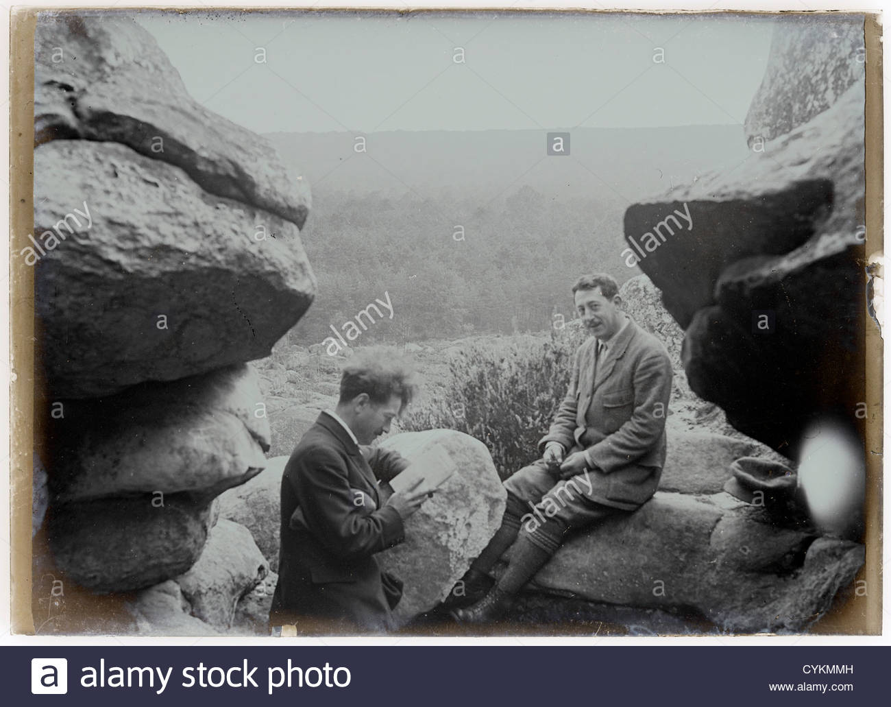 two men resting during a hiking trip early 1900s - Stock Image