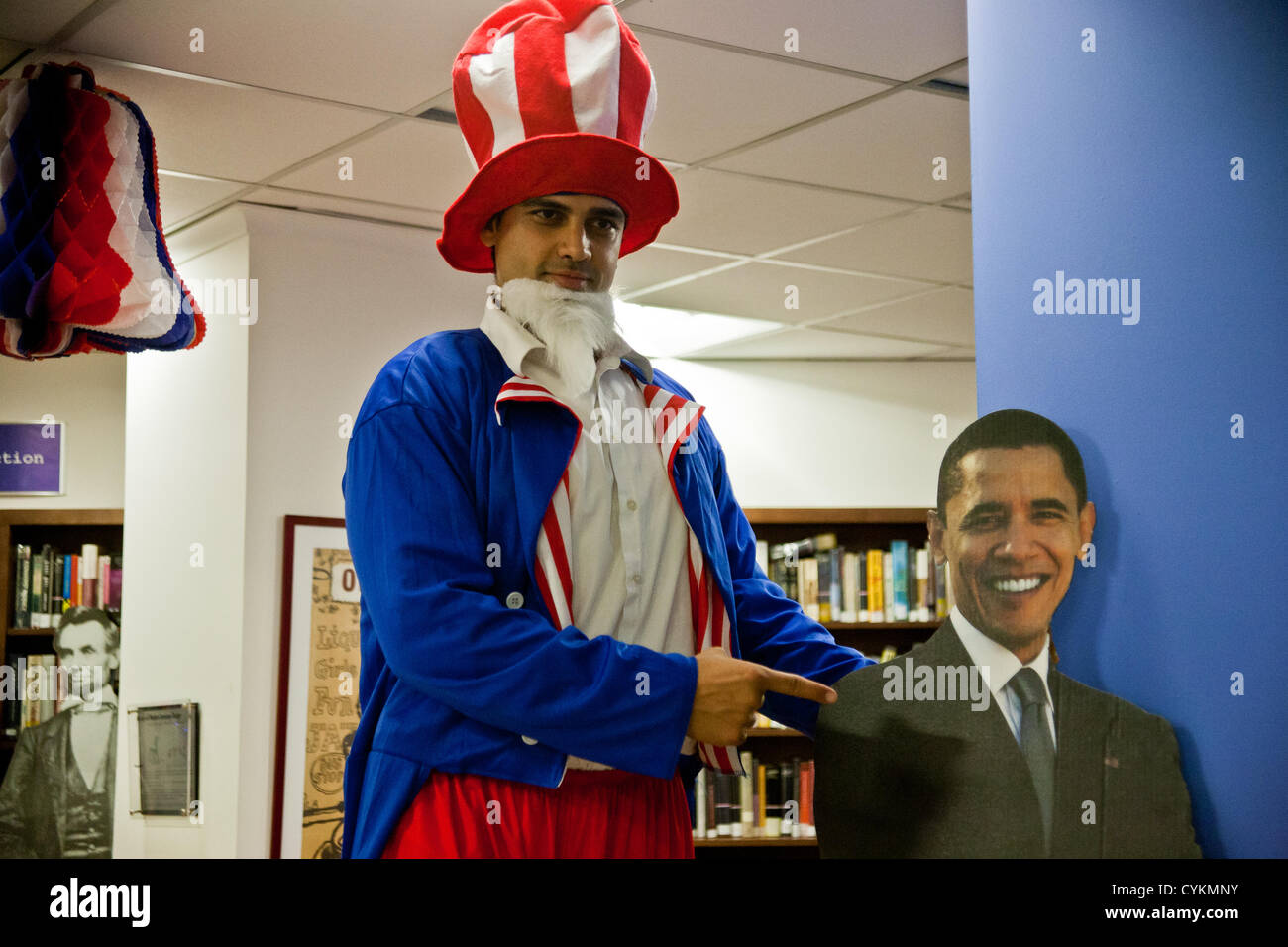 Sri Kulkarni, Director of the American Center in Jerusalem, poses with a cardboard cutout of President Barack Obama - Stock Image