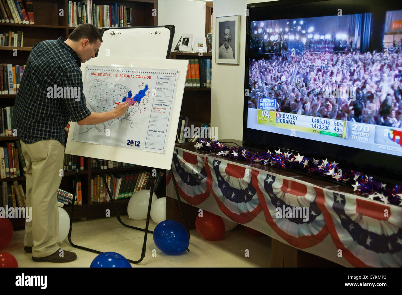 Employees of the American Center in Jerusalem update their own U.S. map with real-time election results based on - Stock Image