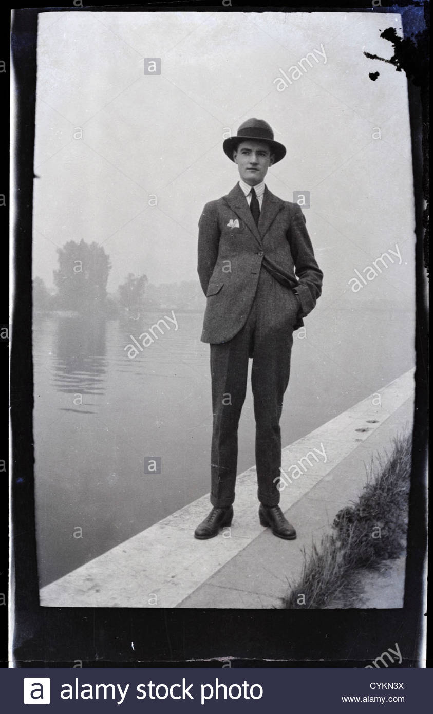 1900s young man standing by river edge - Stock Image