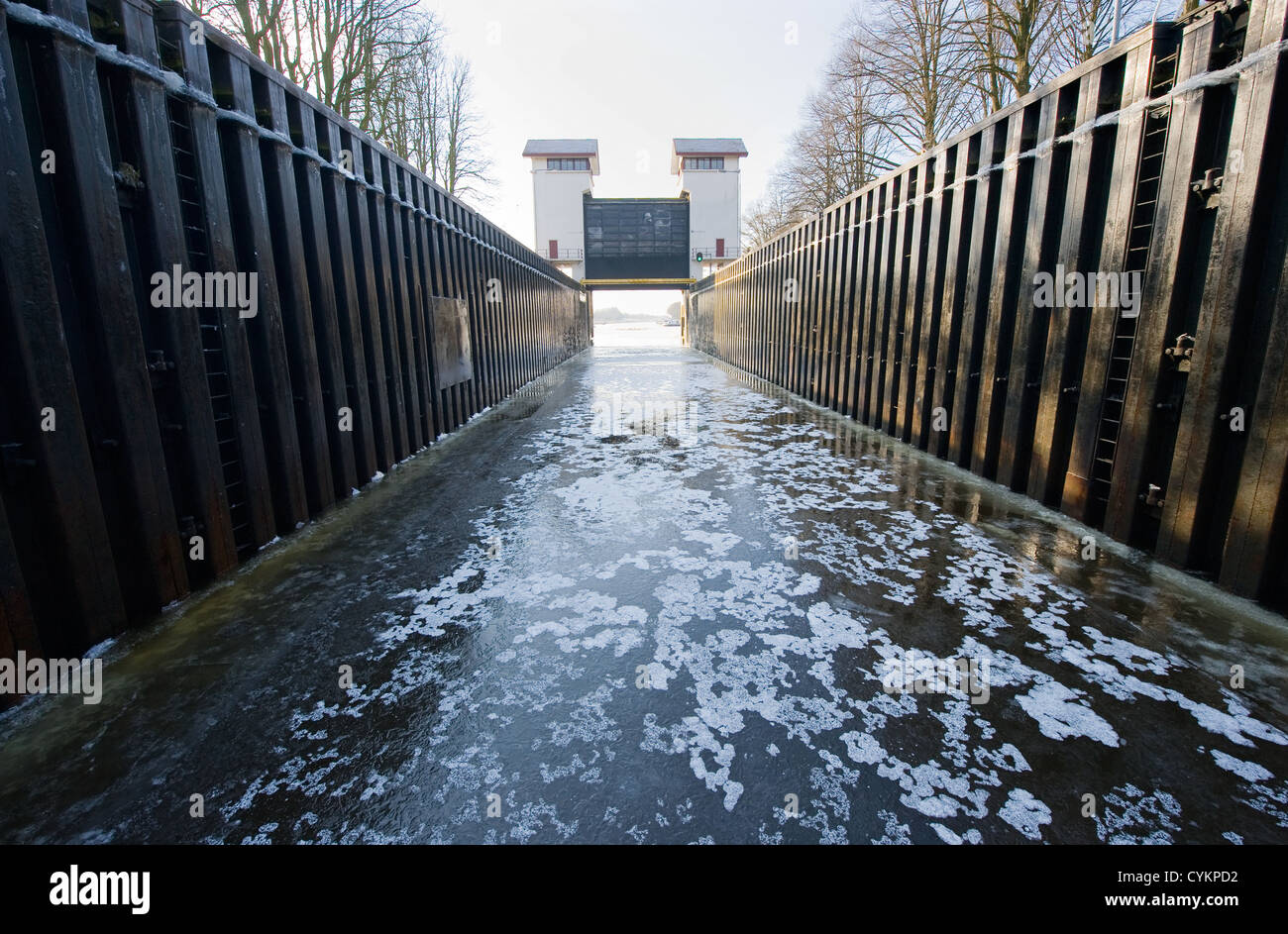 Ice in a sluice in a Dutch canal - Stock Image