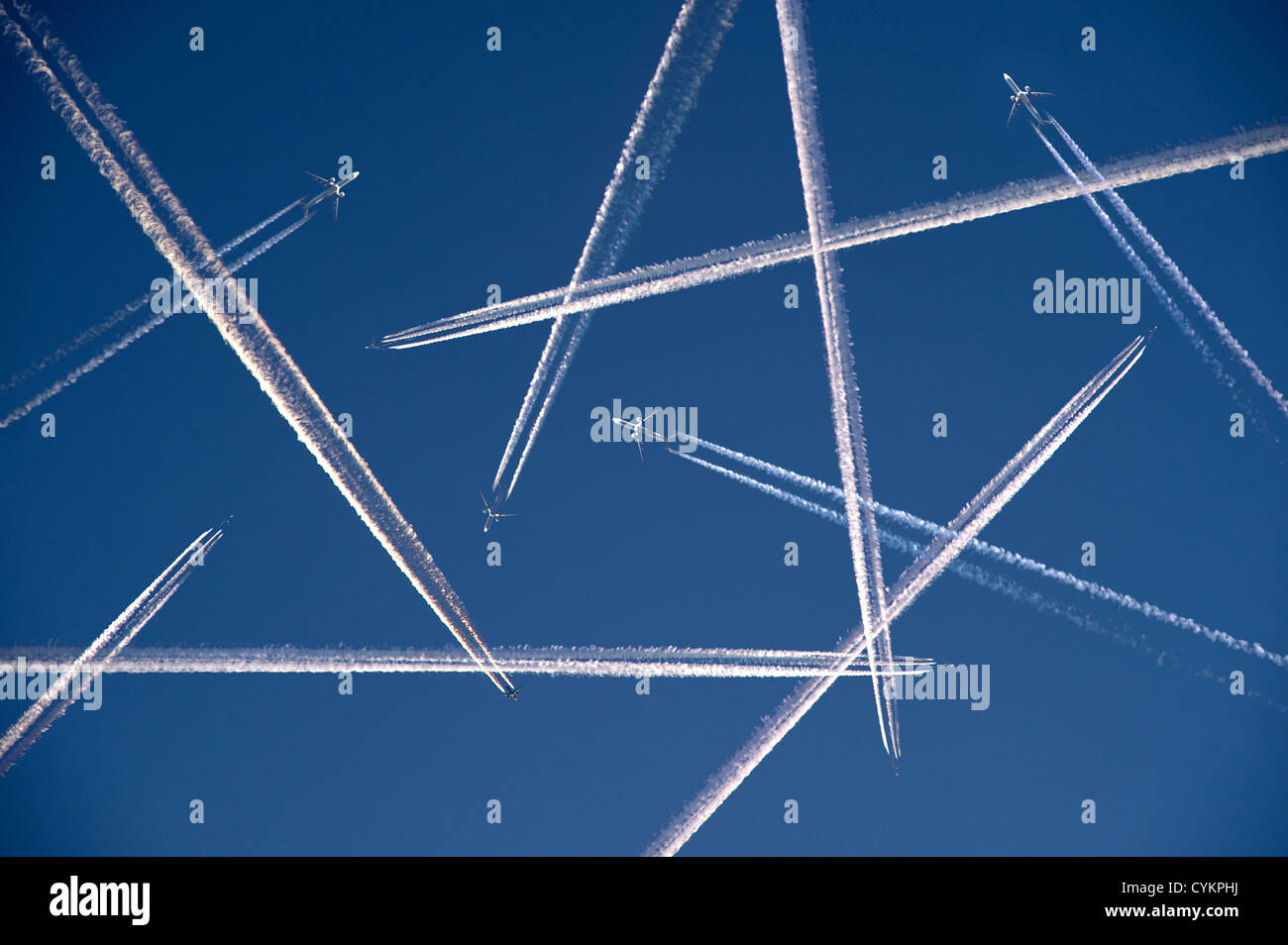 More and more airplanes are flying in the air - Stock Image