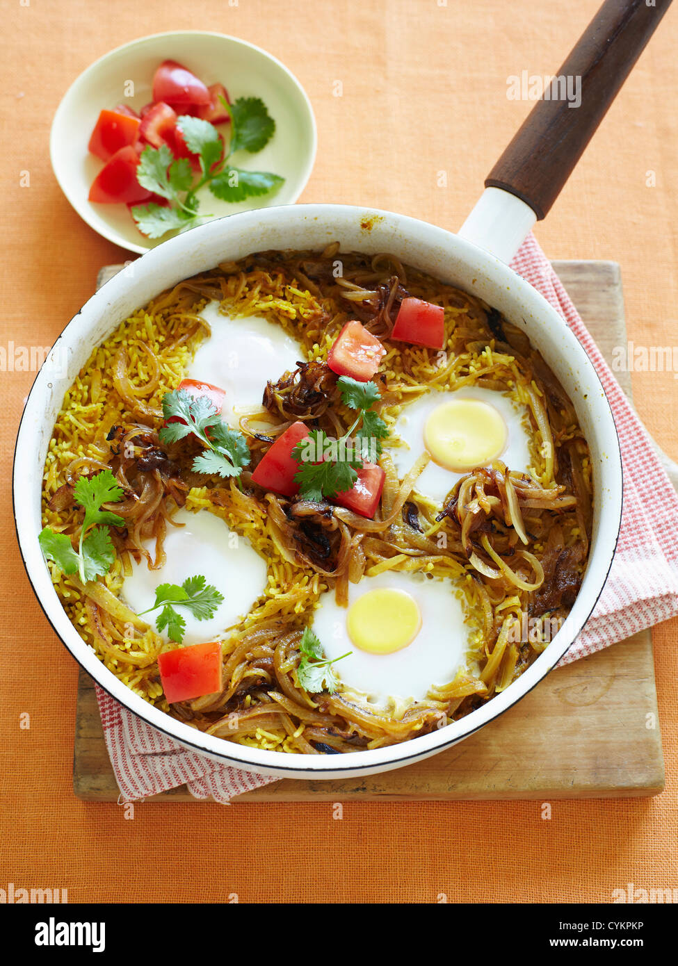 Pan of eggs rice and tomato - Stock Image