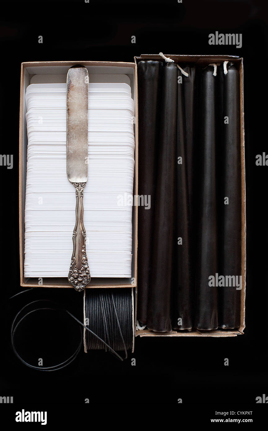 Knife on box of napkins and candles - Stock Image