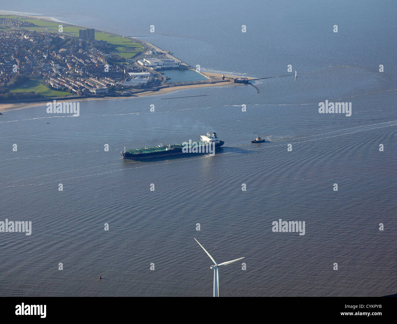 Oil tanker entering at the mouth of the River Mersey, North West England, UK with the Wirral behind - Stock Image