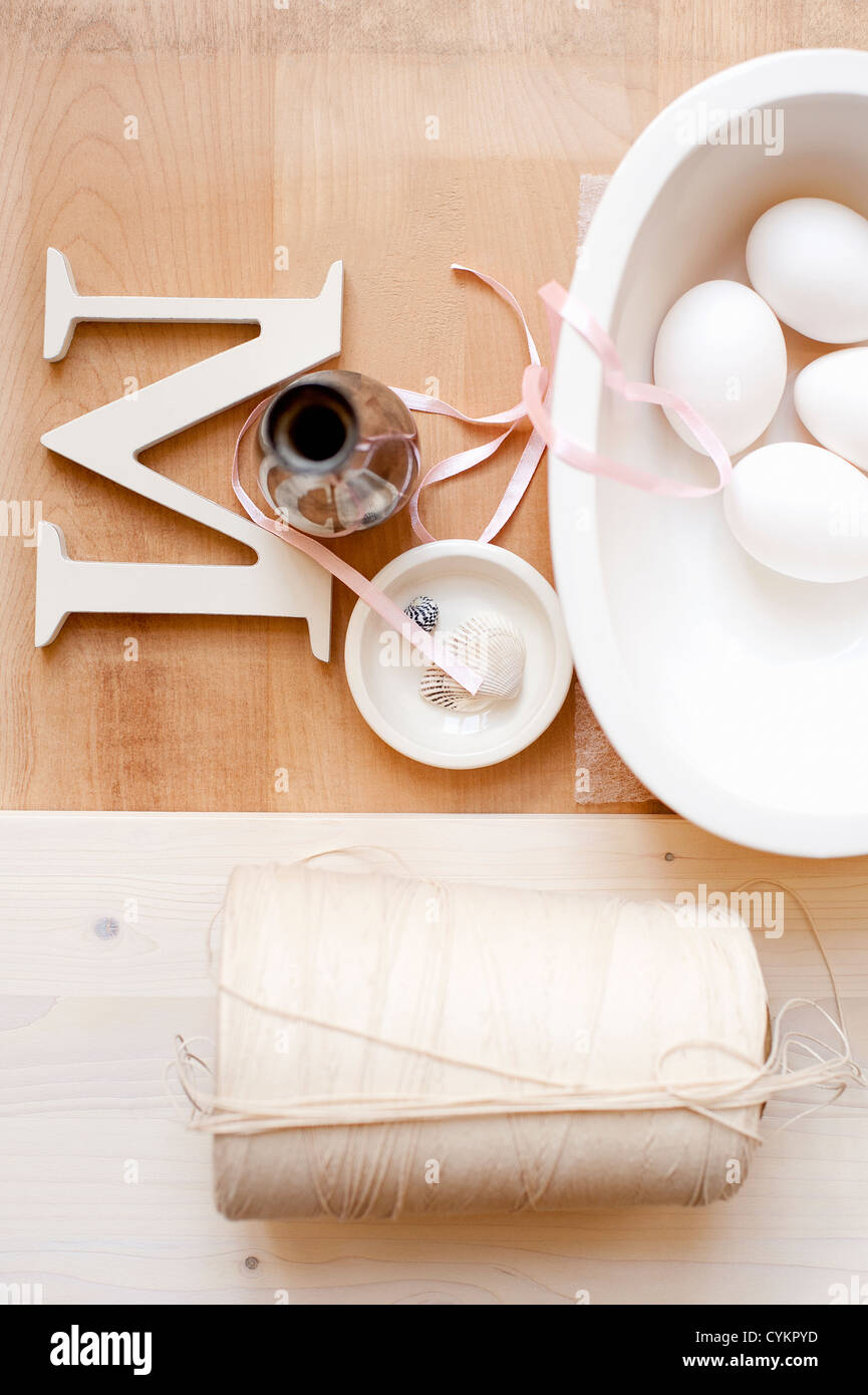 Twine letter M ribbon and eggs - Stock Image