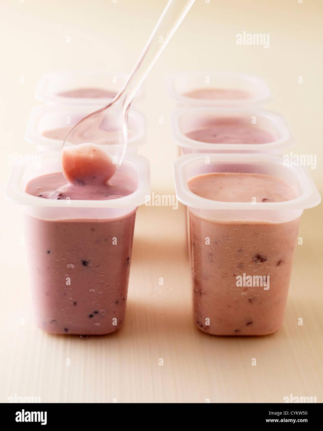 Pots of strawberry and raspberry yogurt - Stock Image