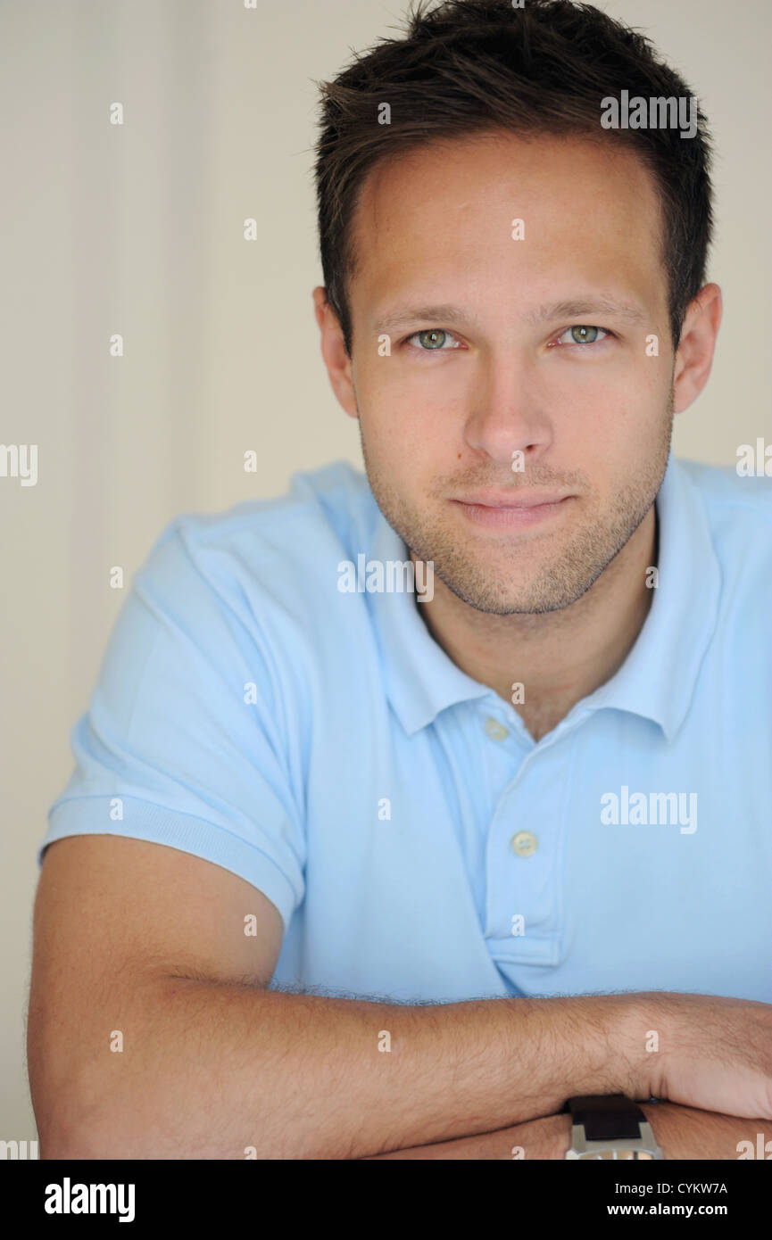 Businessman with arms crossed - Stock Image