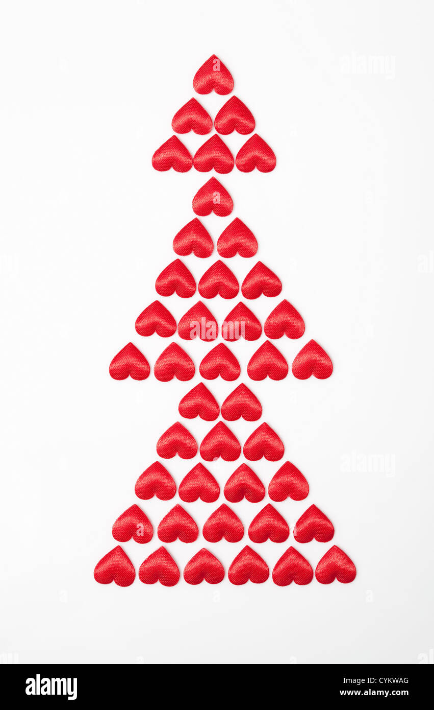 Satin hearts in shape of Christmas tree - Stock Image