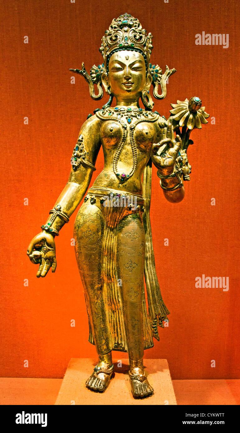 Tara, the Buddhist Savior 14th century Nepalese Nepal Kathmandu Valley copper alloy precious stones  gold paint - Stock Image