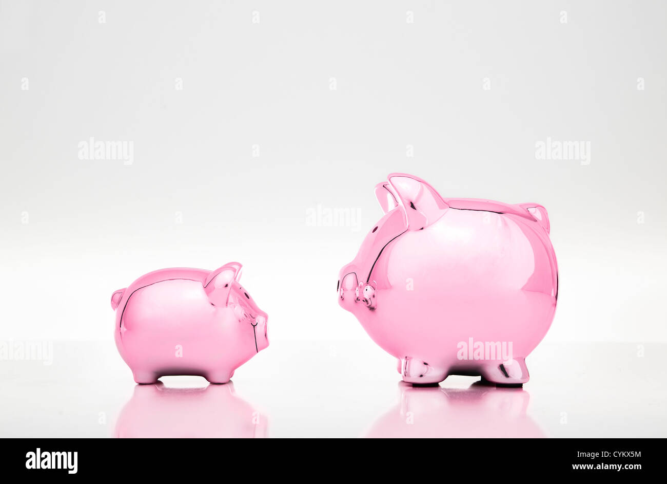 Large and small piggy banks Stock Photo