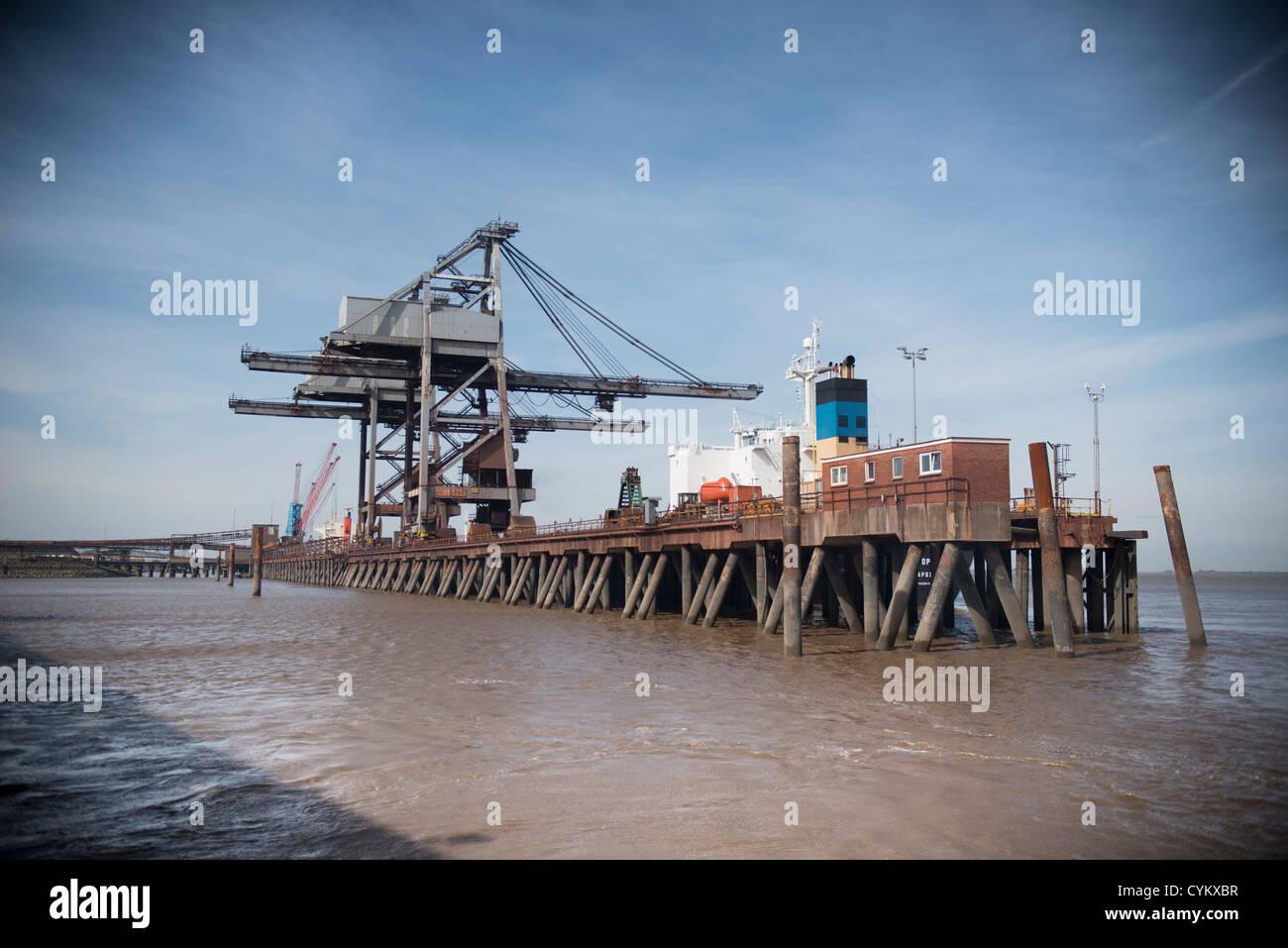 Cranes on wooden pier - Stock Image
