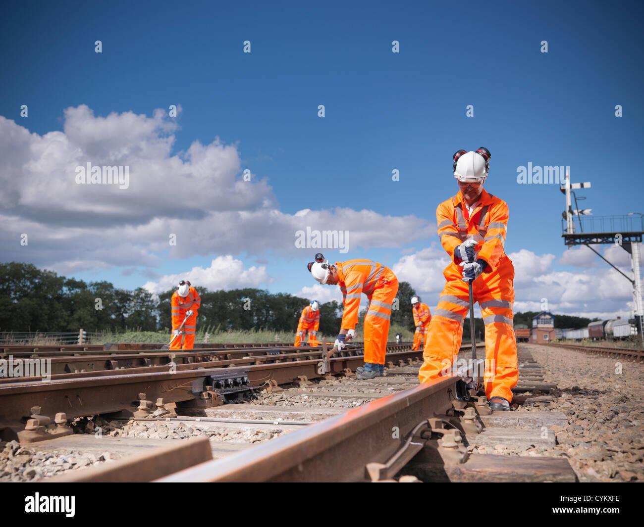 Railway workers adjusting train tracks - Stock Image