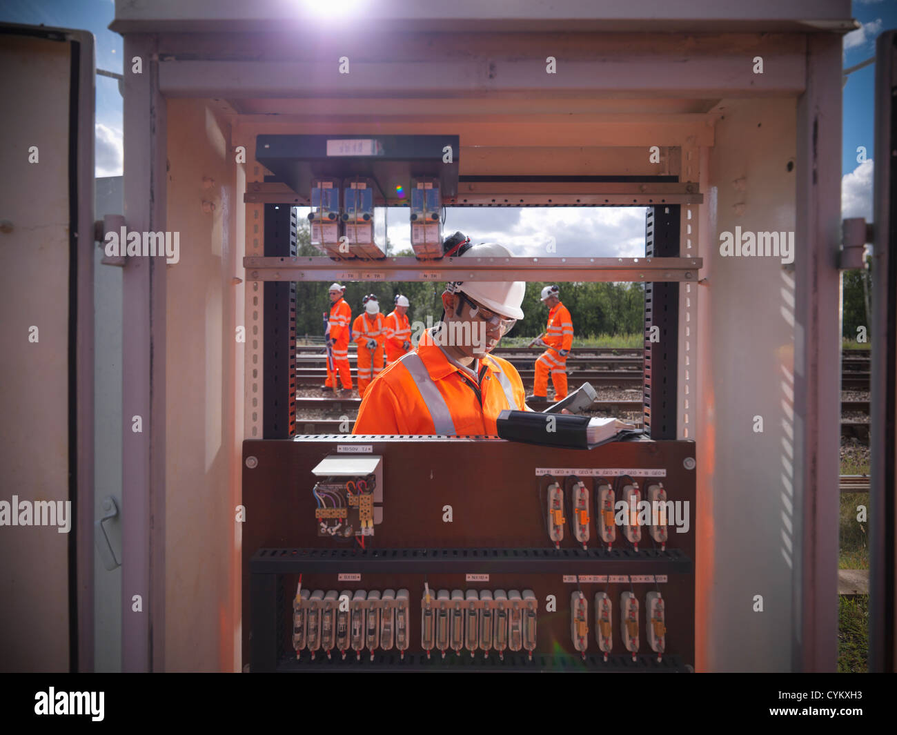 Railway worker at signal station - Stock Image