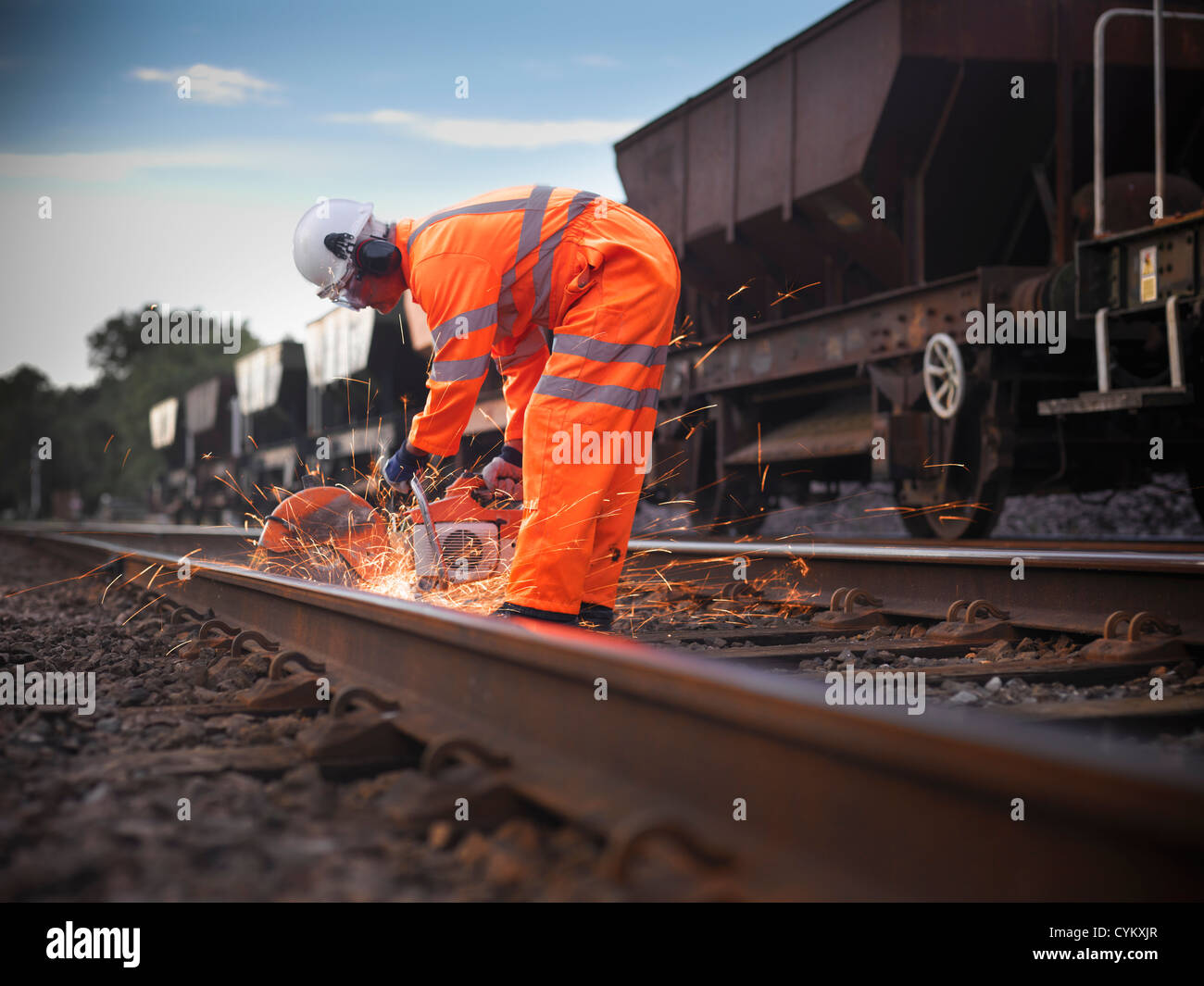 Railway worker adjusting train tracks - Stock Image