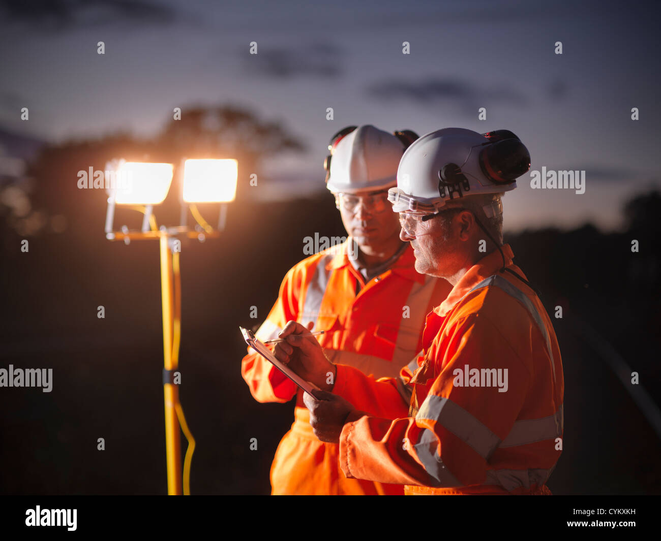 Railway workers writing on clipboard - Stock Image