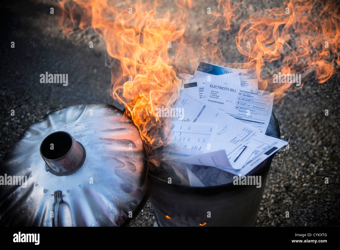 Documents burning in garbage can - Stock Image